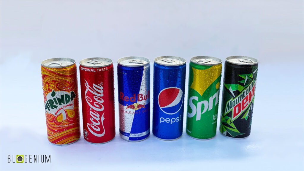 Mirinda, Coca Cola, Red Bull, Pepsi, Sprite, Mountain Dew Soft Drink Cans in Day light