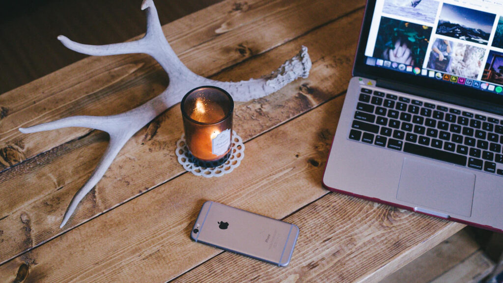 Laptop, iPhone, Candle and Dear Horns
