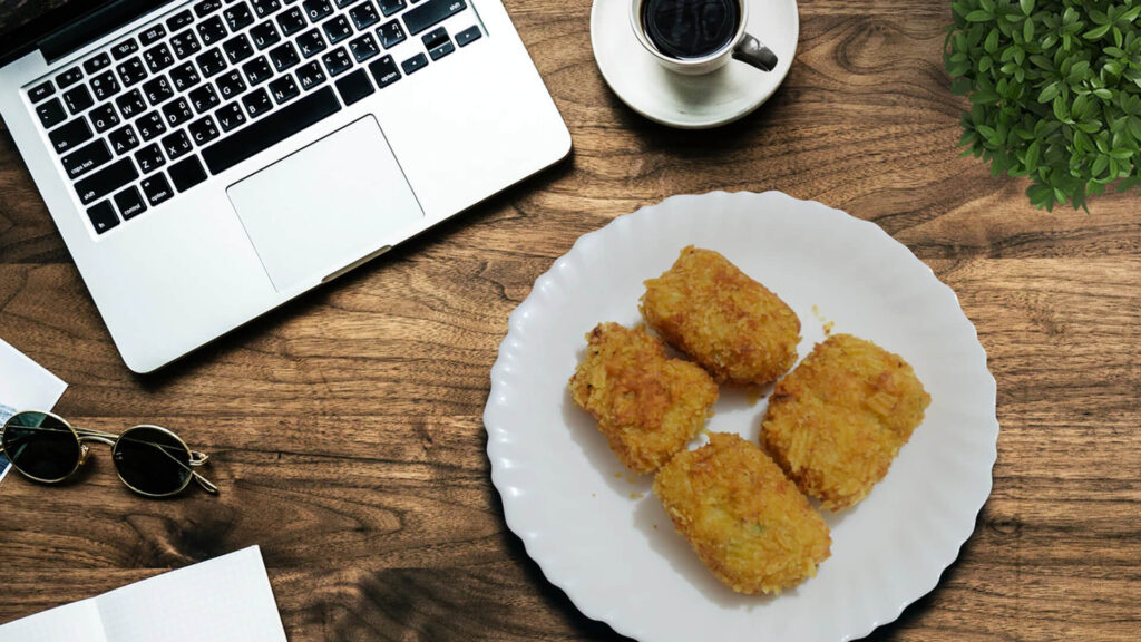 Laptop with Coffee Cup and Nuggets