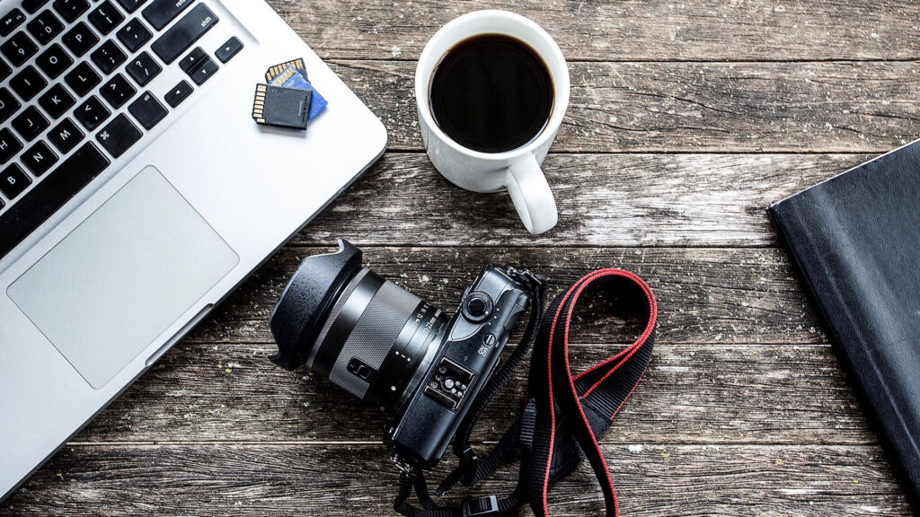 Memory Cards on Laptop with Camera and Coffee Mug